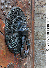 Lion Head Knocker, Ancient bronze handles on old oak door