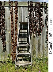 Old step ladder and rusty chains - A rickety old wood step...