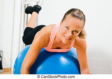 Woman and fitness ball