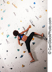 Woman at the climbing wall - Woman African-American...