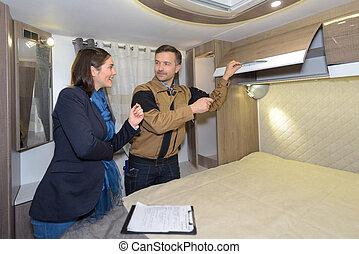 Lady viewing inside of camper van
