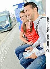 couple waiting for tram