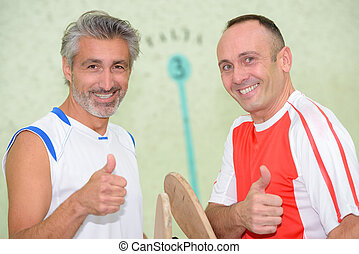 Sportsmen giving thumbs up