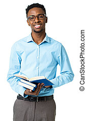 Happy african american college student standing with books in his hands on white