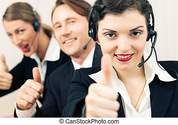 Successful businesspeople - Group of three customer care...