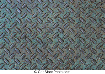 Weathered treadplate background with blue-green patina