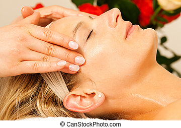 Woman enjoying wellness head massage - Woman enjoying a...