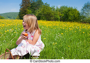 Child on Easter egg hunt with eggs