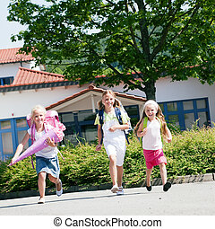 Three schoolchildren having fun - Three kids having fun at...