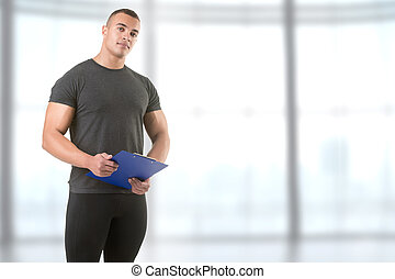 Personal Trainer Holding a Pad