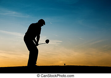 Senior male golf player at sunset - Senior man playing golf...
