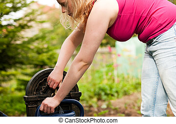 Refilling the watering pot