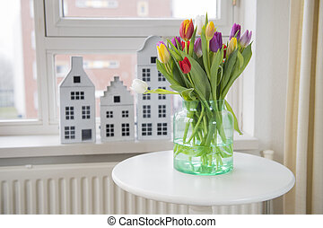 Vase with tulips in interior