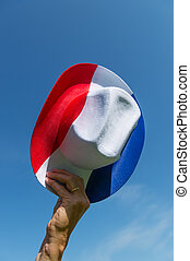 Dutch hat in red white and blue - Hand with Dutch hat in red...
