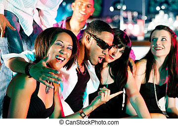 Group of friends in nightclub - Group of friends - men and...