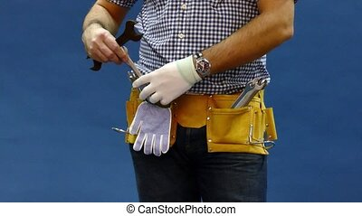 Male Construction Worker With Tool belt. Close up view.