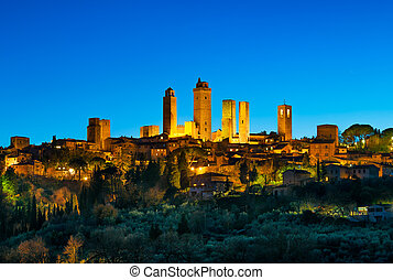 San Gimignano town skyline and medieval towers sunset. Tuscany, Italy