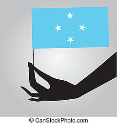 Hand with flag Micronesia - Flag of Micronesia in a female...