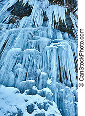 Frozen waterfall in the mountains - Landscape with a frozen...