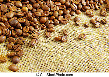 coffee beans on burlap background