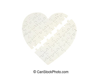 Incomplete jigsaw puzzle in a shape of a heart isolated on...