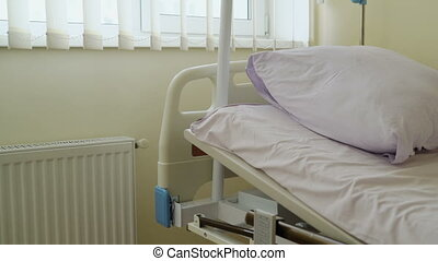 Empty patient room with full electric hospital bed close-up...