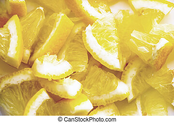 Finely chopped pieces of lemon. Lemon pieces in different...