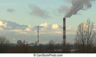 Air pollution by smoke coming out of the factory chimneys in...