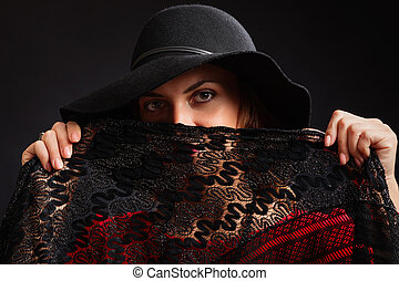 The magnificent beautiful woman in a black wide-brimmed hat...