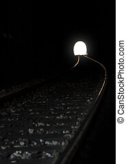 Train way in the tunnel with exit.