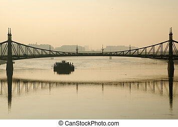 Budapest bridge in haze - Budapest bridge and barge in...