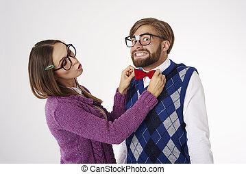 Geek woman adjusting bow tie