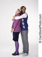 Man geek giving big hug to his girlfriend