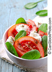 Tomato salad with spinach, cottage cheese, olive oil and...