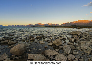 Lake Tekapo, NZ - The rocky shore of Lake Tekapo, New...