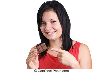 a young woman eating some home made chocolate