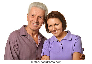 senior man with adult daughter posing against white...