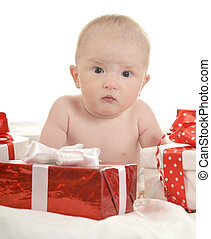 Baby boy sitting with gifts - Portrait of a ?ute baby boy...