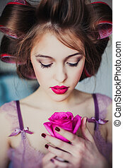 Beauty portrait of young woman wearing curlers - Beautiful...