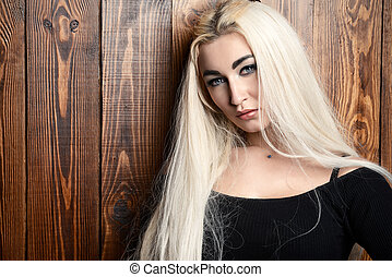 long blonde hair - Young woman with long blonde hair and...
