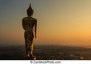 Golden buddha statue in Thai temple, Wat Phra That Khao Noi...