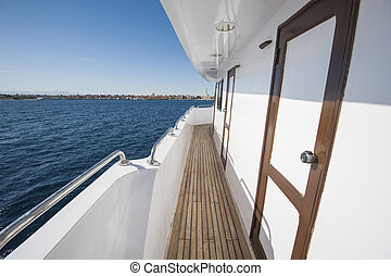 View along gangway of a large private motor yacht out at sea
