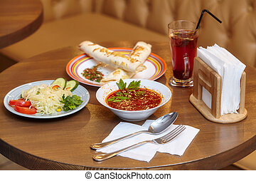 Lunch set with shaurma, red soup and salad, served food -...