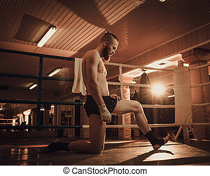 Professional fighter warm-up on training ring.