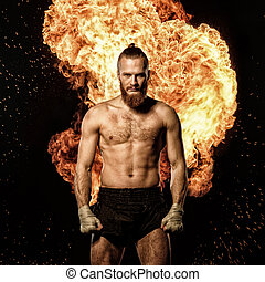 Professional fighter with fire on background.