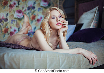 Portrait of young beautiful woman in seductive lingerie. -...