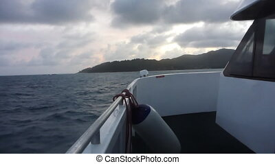 Ship on Indian Ocean at sunset, Seychelles