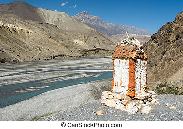 Border stone at the river bank. Entrance to Mustang area...