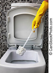 cleaning of white toilet bowl