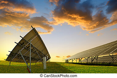 Photovoltaic panels at sunset. Power plant using renewable...